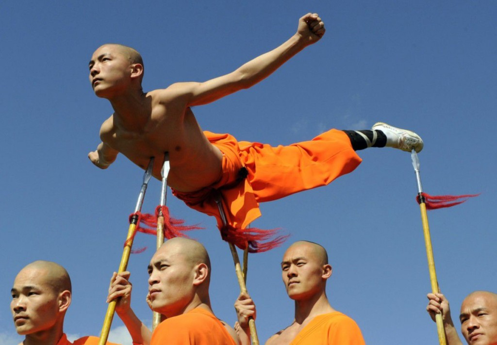 Shaolin Wu-Shu Warriors lift a colleague using spears during a photocall at the Chinese State Circus at Alexandra Palace in London