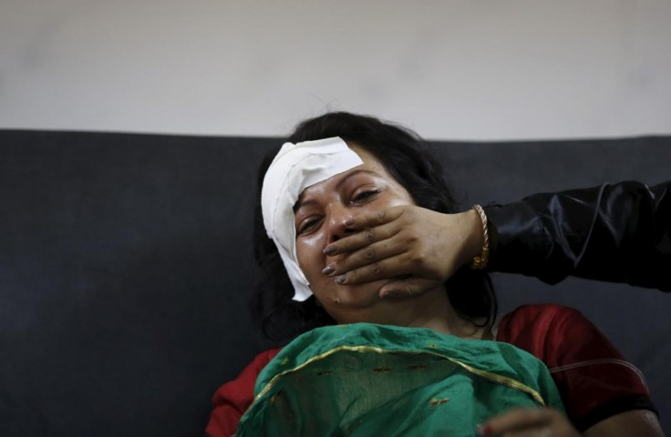 Injured woman cries after hearing news of a family member who died during an earthquake at a trauma center in Kathmandu