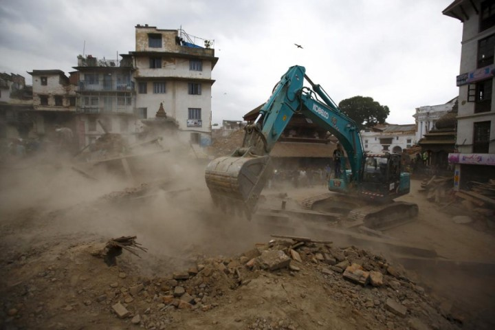 Excavator digs the rubble to search for the bodies after an earthquake hit, in Kathmandu, Nepal